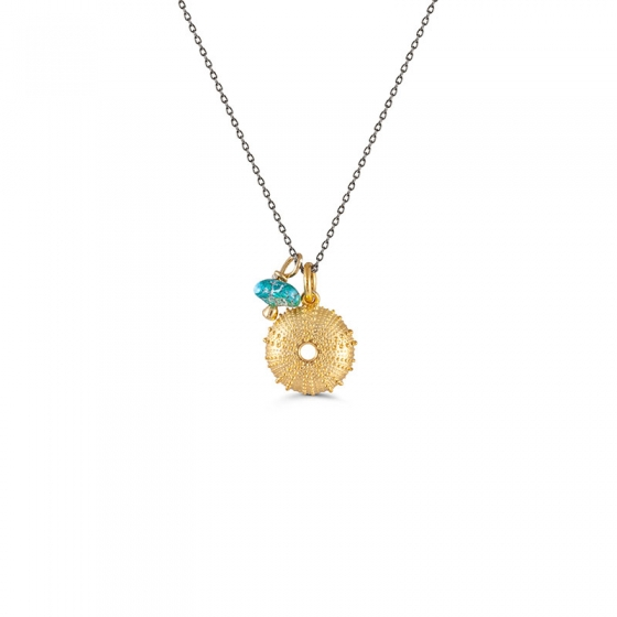 Sea urchin pendant  made of gold plated silver and ''sea scent''. Attached with a small turquoise stone on a black chain.