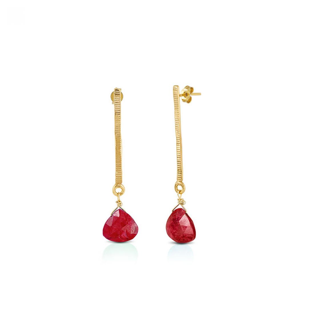 Earrings with line-hammered gold bars and drop-cut ruby stones.