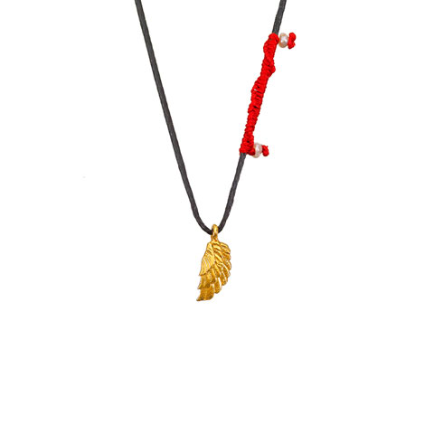 A single gold angel's wing charm with red macrame detail and pearls